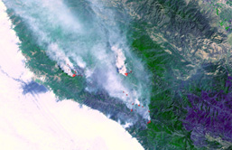 A high altitude aerial view of forest fires in California.