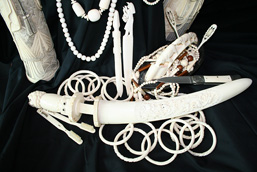 Dagger, bracelets, necklaces, sculptures, pocketknife, toothbrushes, ivory utensils and paper cutter.