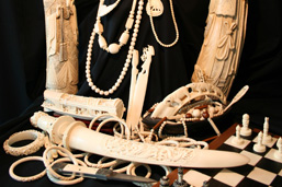 Objects made from elephant ivory: sculptures, bracelets, necklaces, chess pieces and board, paper cutters, chopsticks, ivory utensils and toothbrushes.