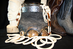 Various objects made from elephant anatomical parts: sculptures, ivory bracelets and necklaces, baby elephant foot made into a container, elephant skin boot.