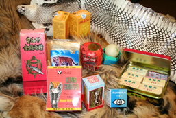 Various products of the traditional Asian medicine: whole tiger skin, cobra skin, capsules in boxes, bandages, ointments.
