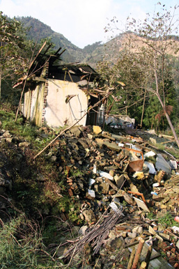 A small house in the mountains demolished after an earthquake.